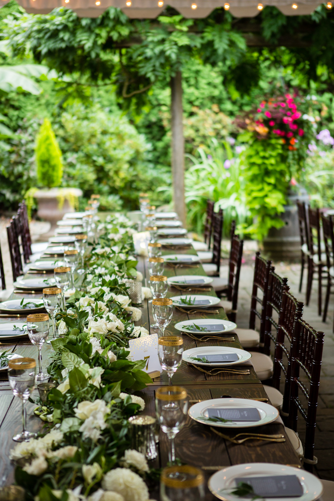 Barnwood Table rentals by Seattle Farm Tables -Photo by La Vie Photography, Venue - Delille Cellars in Woodinville, WA - Classic greenery with white florals. Gold rimmed glasses on dark wood. Wedding table scape - We rent wood tables in the Puget Sound area, Seattle, Tacoma, Woodinville, Eastside, San Juan Islands, Snohomish, Kitsap, Seatac Washington. Rustic tables, winery rentals, vineyard tables, fancy, classy, classic design