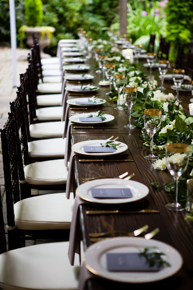 Barnwood Table rentals by Seattle Farm Tables -Photo by La Vie Photography, Venue - Delille Cellars in Woodinville, WA - Classic greenery with white florals. Gold rimmed glasses on dark wood. Wedding table scape - We rent wood tables in the Puget Sound area, Seattle, Tacoma, Woodinville, Eastside, San Juan Islands, Snohomish, Kitsap, Seatac Washington. Outdoor wedding, long table. Rustic tables, winery rentals, vineyard tables, fancy, classy, classic design