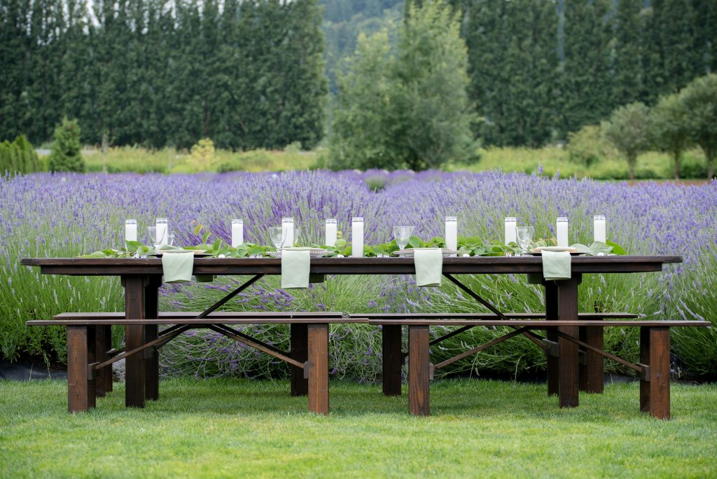 Barnwood Table rentals by Seattle Farm Tables -Photo by Jeff and Rebecca Photography, Venue - Woodinville Lavendar in Woodinville, WA, tables in a meadow, lavender and brown- We rent wood tables in the Puget Sound area, Seattle, Tacoma, Woodinville, Eastside, San Juan Islands, Snohomish, Kitsap, Seatac Washington. Rustic tables, winery rentals, vineyard rentals, wedding table rentals, classic design